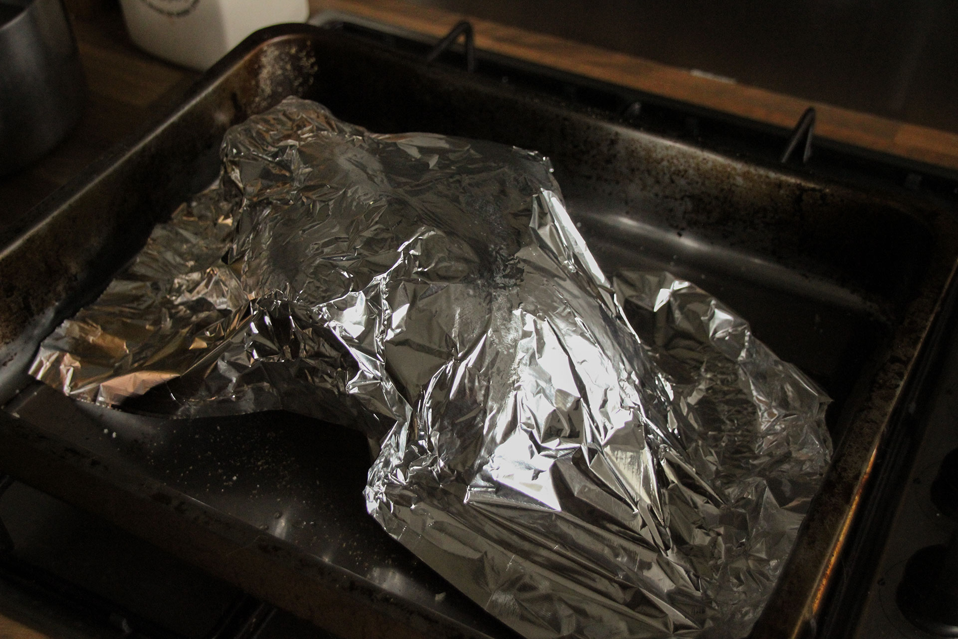 Chicken covered with tin foil