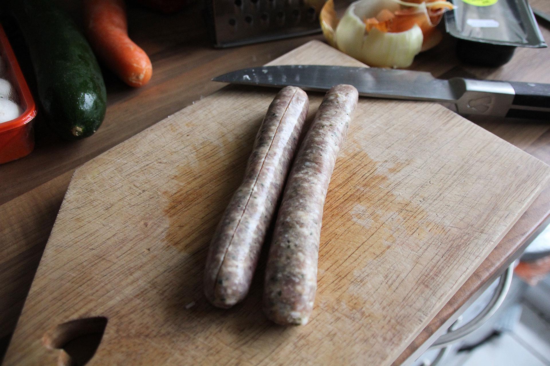 Slice lengthwise along sausage